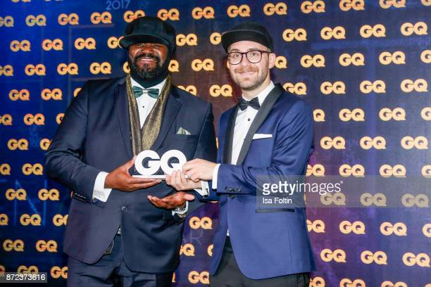 US singer and award winner Gregory Porter and German singer and award winner Mark Forster during the GQ Men of the year Award 2017 show at Komische...
