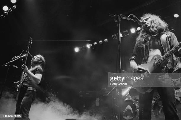 Singer and bassist Ian 'Lemmy' Kilmister and guitarist 'Fast' Eddie Clarke of English rock band Motorhead in concert circa 1977