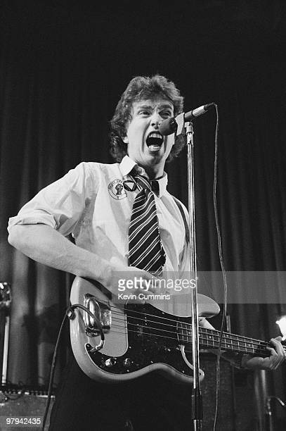 Singer and bassist Tom Robinson of the Tom Robinson Band performs on stage at the Middleton Civic Hall in Manchester England on October 05 1977