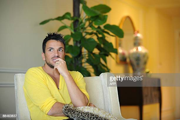 Singer and British TV personality Peter Andre talks to the media in his room at the Venetian Hotel on the third and final day of the 10th...