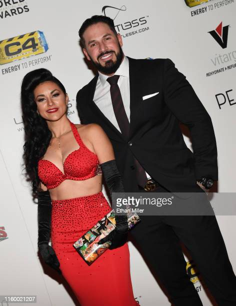 Singer and burlesque dancer Melody Sweets and Mikey Perez attend the 11th annual Fighters Only World MMA Awards at Palms Casino Resort on July 3 2019...