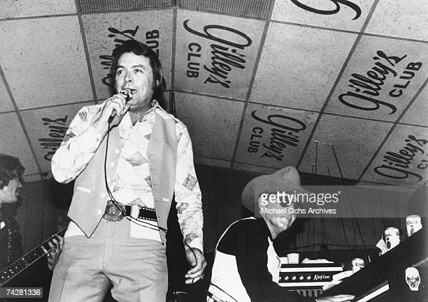 Singer and club owner Mickey Gilley performs with his cousin piano player Jerry Lee Lewis at Gilley's Club in Pasadena Texas in circa 1975