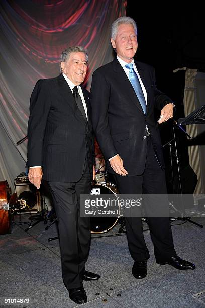 Singer and cofounder of Exploring the Arts organization Tony Bennett and former president Bill Clinton attend the Exploring the Arts Gala at Cipriani...
