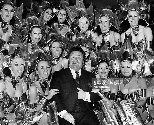 Singer and comedian Harry Secombe surrounded by the Pamela Davis Dancers during a rehearsal for a Royal Variety Performance at the London Palladium