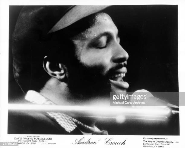 Singer and composer Andrae Crouch plays the piano as he sings in to a microphone in circa 1976