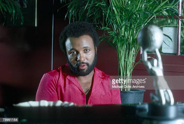 Singer and composer Andrae Crouch plays the piano at his home in October 1982