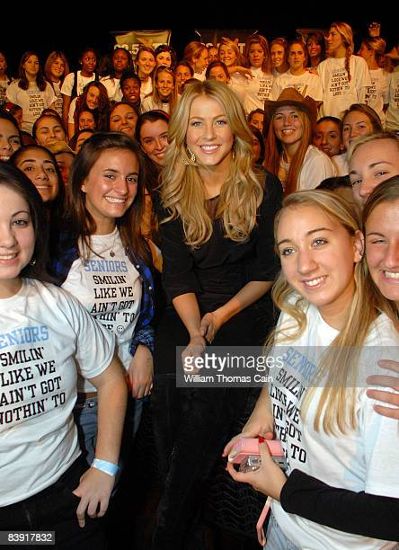 Singer and dancer Julianne Hough formerly of Dancing With The Stars poses with some students at Merion Mercy Academy December 4 2008 in Lower Merion...
