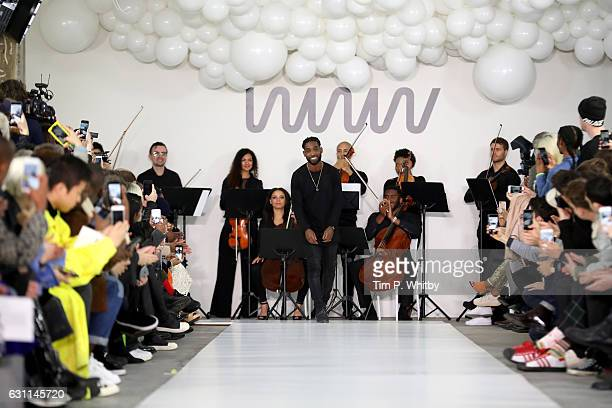 Singer and designer Tinie Tempah salutes the crowd following the What We Wear show during London Fashion Week Men's January 2017 collections at BFC...