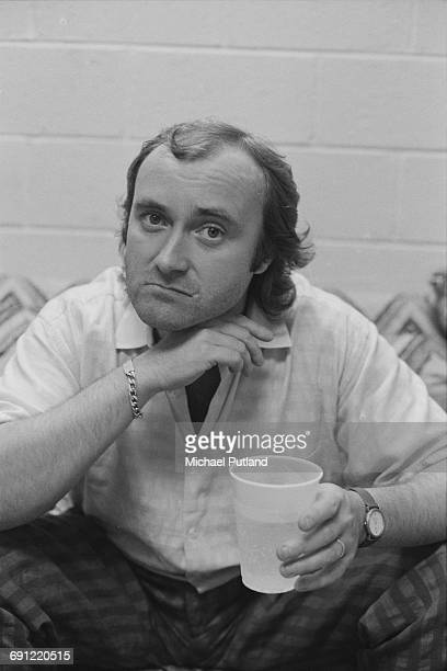 Singer and drummer Phil Collins of English rock group Genesis backstage at the Rosemont Horizon Rosemont Illinois during the band's Invisible Touch...