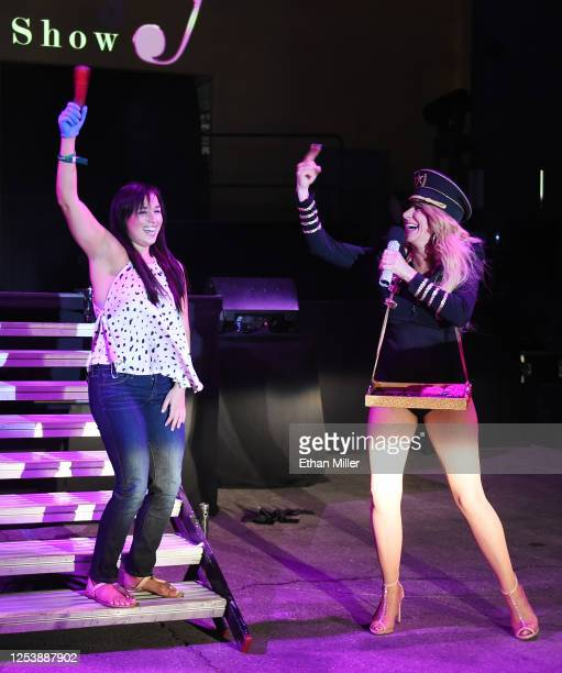 Singer and emcee Gabriella Versace jokes around with audience member Kristen Fernandez of Nevada during a performance of SEXXY The Show at the...