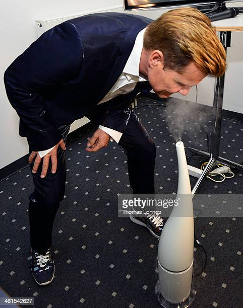 Singer and Entertainer Dieter Bohlen smells on a air humidifier before he presents at the fair 'Heimtextil 2014' his wallpaper collection 'Studio...
