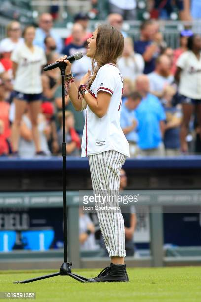 Singer and entertainer Lauren Daigle sings God Bless America during the MLB game between the Atlanta Braves and the Colorado Rockies on August 19...