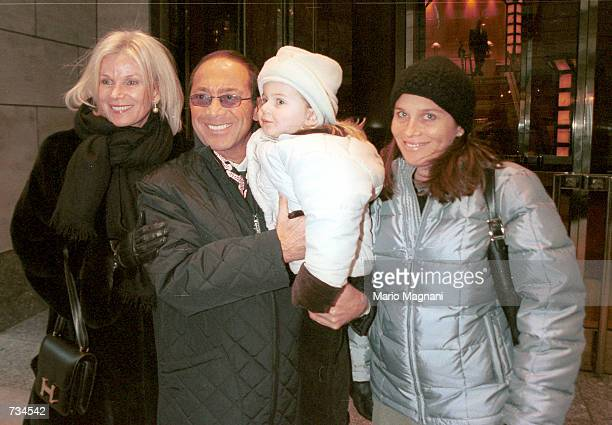 Singer and entertainer Paul Anka holds his grandaughter Allegra while posing November 21 2000 on 5th Avenue in Manhattan Anka who recently separated...