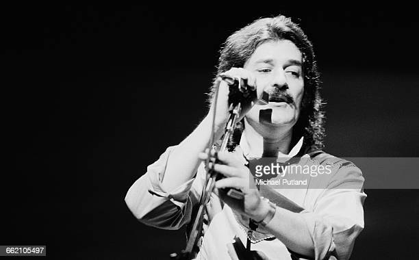 Singer and flautist Ray Thomas performing with English rock group The Moody Blues 1981