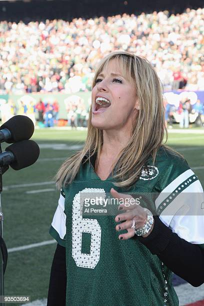 Singer and former WWE RAW personality Lilian Garcia performs the national anthem during the Carolina Panthers football game against the New York Jets...