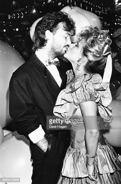 Singer and glamour model Samantha Fox and her boyfriend disgraced businessman Peter Foster kissing at a party April 1987