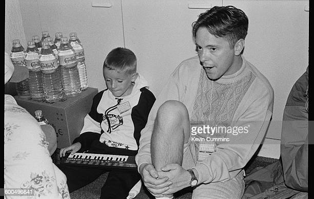 Singer and guitarist Bernard Sumner of English rock group New Order backstage at the Reading Festival 25th August 1989