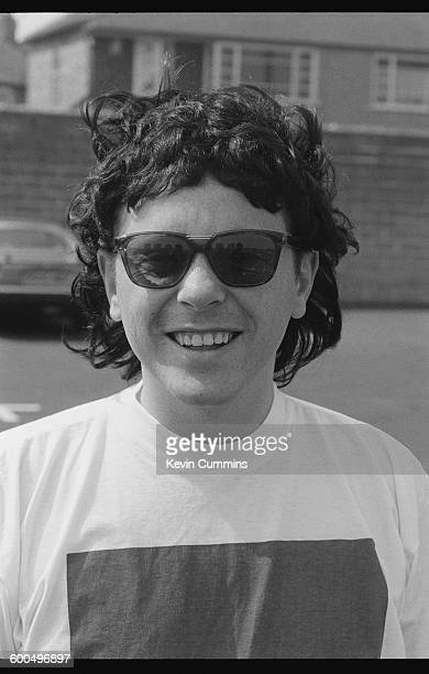 Singer and guitarist Bernard Sumner of English rock group New Order wearing a wig after the group recorded the official song of the England football...
