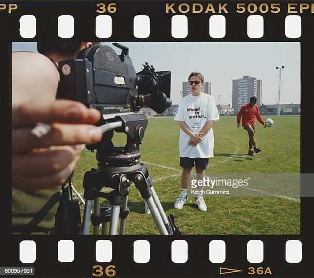 Singer and guitarist Bernard Sumner of English rock group New Order being filmed after the group recorded the official song of the England football...