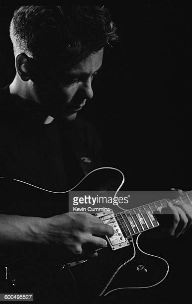 Singer and guitarist Bernard Sumner performing with English rock group New Order at Salford University 17th April 1985