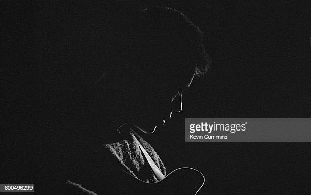 Singer and guitarist Bernard Sumner performing with English rock group New Order at Victoria Hall Hanley Staffordshire 10th May 1983