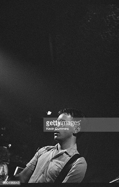 Singer and guitarist Bernard Sumner performing with English rock group New Order at the Ritz Manchester 26th October 1981