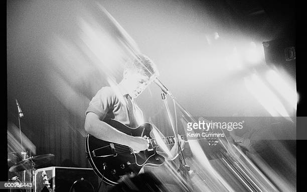 Singer and guitarist Bernard Sumner performing with English rock group New Order at Comanche Student Union Manchester Polytechnic 6th February 1981