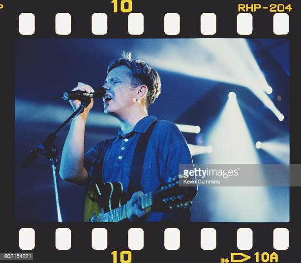 Singer and guitarist Bernard Sumner performing with English rock group New Order circa 1990