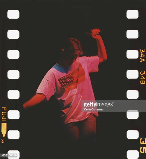 Singer and guitarist Bernard Sumner performing with English rock group New Order at Meadowlands New Jersey USA 19th July 1989