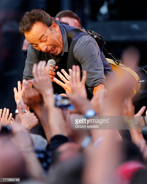 Singer and guitarist Bruce Springsteen performs during his concert at the Molinon stadium in Gijon, northern Spain, on June 26, 2013. AFP PHOTO/...