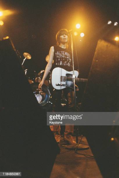 Singer and guitarist Chrissie Hynde of rock band The Pretenders in concert at the Lyceum in London, 14th December 1981.