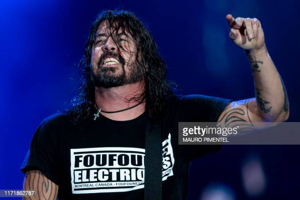 Singer and guitarist Dave Grohl of US rock band Foo Fighters performs onstage during the Rock in Rio festival at the Olympic Park, Rio de Janeiro,...