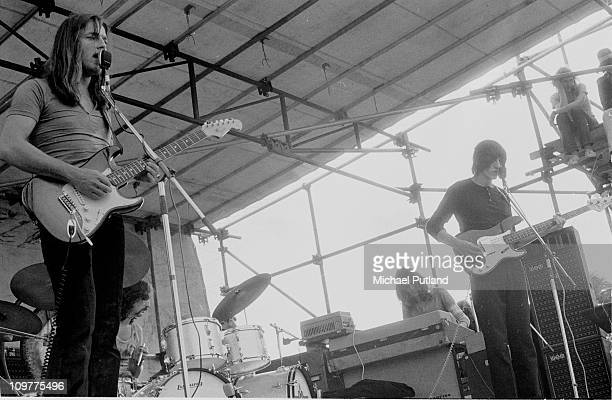 Singer and guitarist David Gilmour drummer Nick Mason keyboard player Rick Wright and bassist Roger Waters of Pink Floyd performing on stage in Hyde...