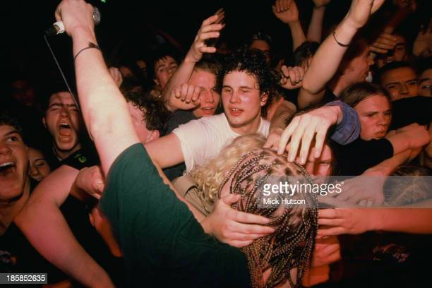 Singer and guitarist Dexter Holland joins the audience during a concert by American punk group The Offspring London 1995