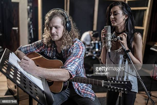 singer and guitarist in recording studio - rehearsal stock pictures, royalty-free photos & images