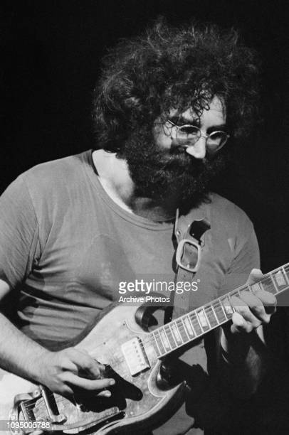 Singer and guitarist Jerry Garcia performing with American rock group The Grateful Dead at the Woodstock Music Festival Bethel New York 16th August...