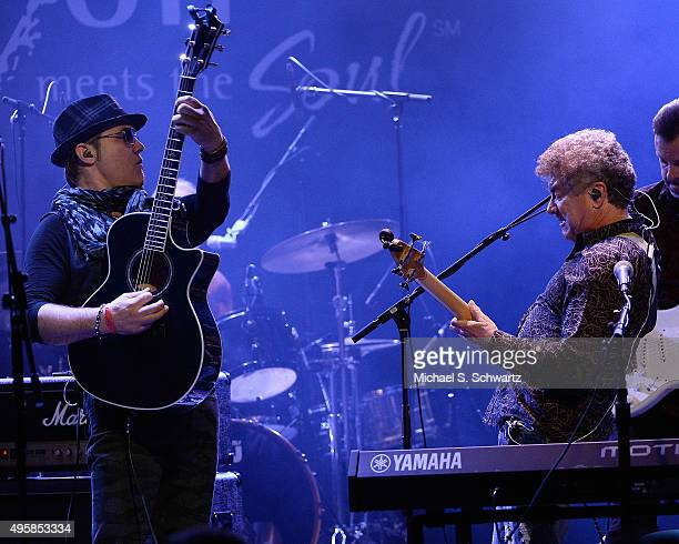 Singer and guitarist Ken Stacey and singer and bassist Joe Puerta of Ambrosia perform during their appearance at the weSpark Cancer Support Center...