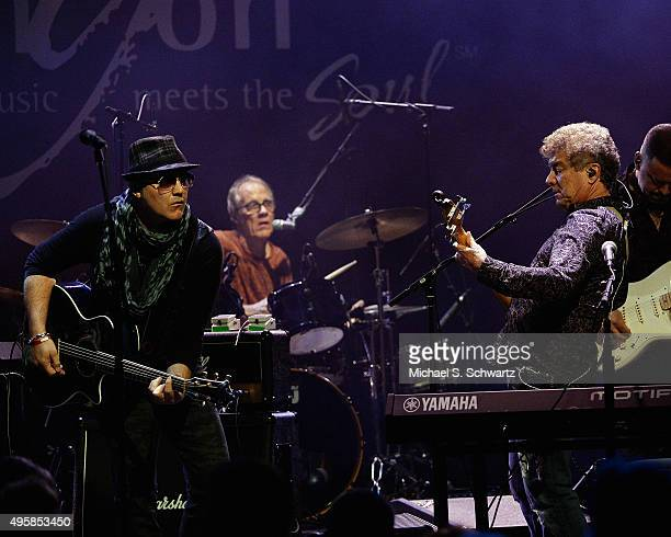 Singer and guitarist Ken Stacey, drummer Burleigh Drummond and singer and bassist Joe Puerta of Ambrosia perform during their appearance at the...