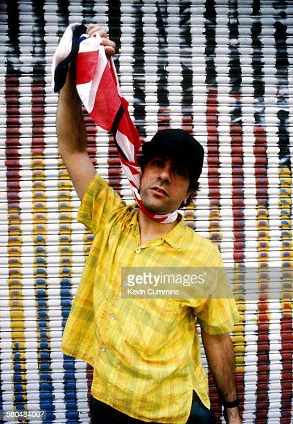 Singer and guitarist Lee Ranaldo of American alternative rock group Sonic Youth simulates hanging himself with a stars and stripes flag New York City...