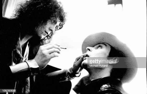 Singer and guitarist Marc Bolan of T-Rex applies make up to fellow band member Mickey Finn backstage at a television studio on 4th June 1973.