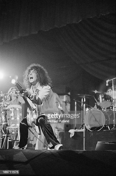 Singer and guitarist Marc Bolan performing with English glam rock group TRex at the Odeon Birmingham 9th June 1972 In the background are...