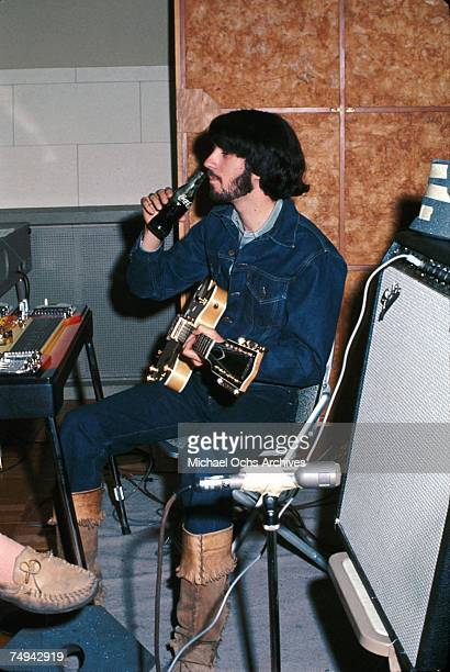 """Singer and guitarist Michael Nesmith of the pop band """"The Monkees"""" drinks a Coke while holding a guitar in the recording studio in 1969 in Los..."""