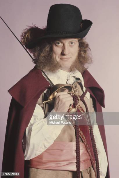 Singer and guitarist Noddy Holder of English rock group Slade posing in a cavalier costume and holding a sword London 1974