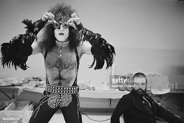 Singer and guitarist Paul Stanley American heavy metal group Kiss peering through a pair of doughnuts, backstage during the band's Rock & Roll Over...