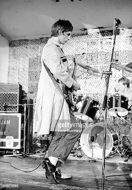 Singer and guitarist Paul Weller of English rock group The Jam soundchecking at the Electric Circus Manchester 19th June 1977 Drummer Rick Buckler...