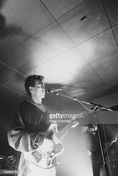 Singer and guitarist Robert Smith performing with English pop group The Cure at the Russell Club Manchester 26th April 1980