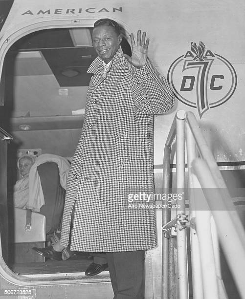 Singer and Jazz musician Nat King Cole boarding an American Airlines airplane 1960