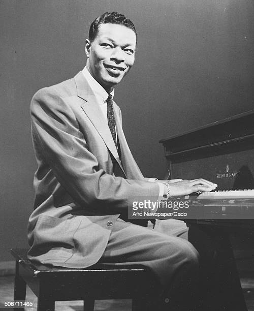Singer and Jazz musician Nat King Cole playing the piano 1953