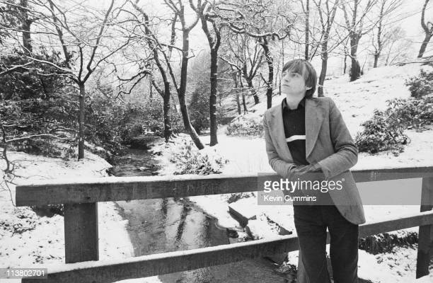 Singer and lyricist Mark E Smith of English rock group The Fall on a bridge in a snowy park 16th January 1981