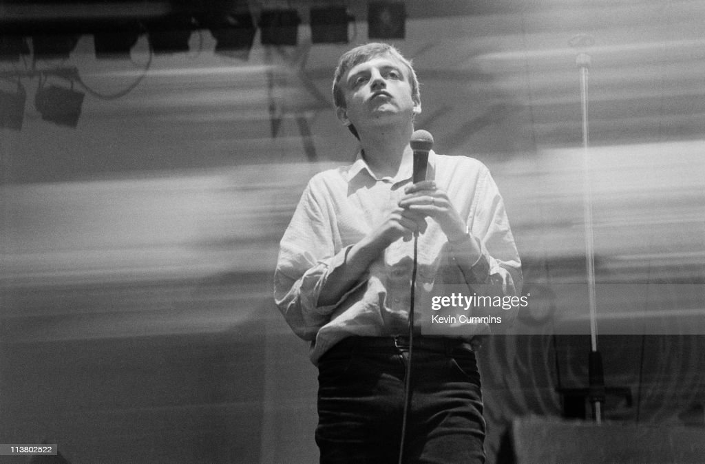 Singer and lyricist Mark E Smith of The Fall, performing at the GMEX centre (now Manchester Central), Manchester, during the Festival Of The 10th Summer, 19th July 1986.